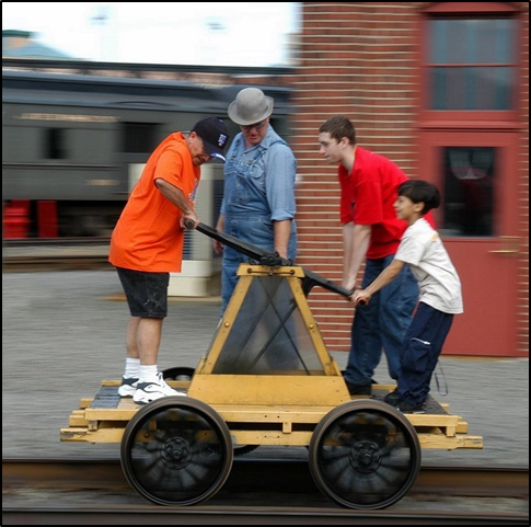 Students using a hand pump car