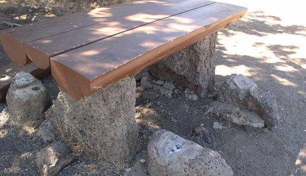 Some existing picnic tables can be retrofitted as accessible. This 'before' photo shows an inaccessible picnic table constructed as a CCC project around 1940.