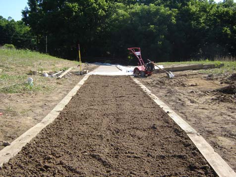 Polypavement is applied to a base of compacted native soils and mixed into an additional 2 inches of tilled soil.