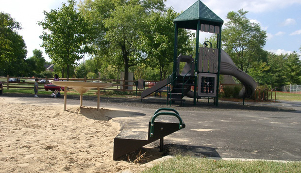 This transfer system can enable a child to transfer from his assistive device to the sand.