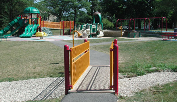 One color scheme is used for equipment serving children 2 to 5 years and other color scheme is used for equipment serving children 5 to 12 years. An alternate color scheme is used to offset safety barriers and railings from actual climbing equipment.
