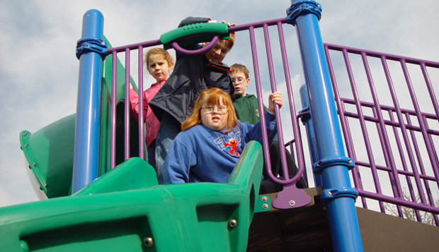 Care has been taken to design openings on elevated structures that permit the passage of one child at a time to use the slide or climber, while prohibiting unintended use or passage.