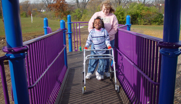 This route on the elevated composite play structure is wide enough to accommodate a child using a walker and her caregiver.